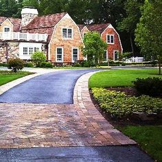 Dress up asphalt driveway with pavers or borders