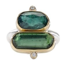 This uniquely designed doublet ring features two rose-cut emerald green tourmaline gems surrounded by satellite diamond accents on a comfortable, rounded silver band.  Jamie Joseph at Greenwich Jewelers, $1310