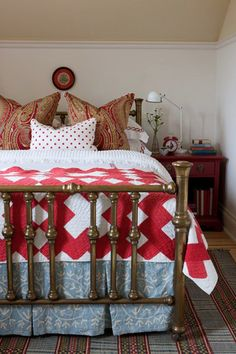 sarah richardson red and white and light blue farmhouse bedroom, brass bed, antique quilt, paisley