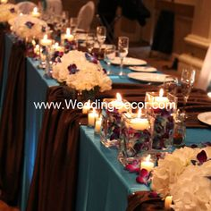 Wedding Decor  Head Table - blue linens, brown runners, hydrangea and blue dendrobium orchids in glass vases with floating candles