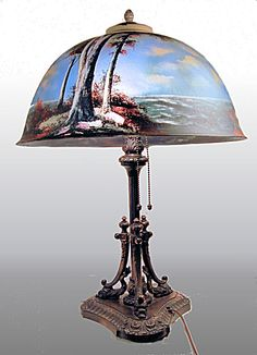 finest quality Pittsburgh reverse painted lamp w/dolphin base. Click on the image for more information.