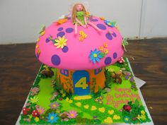 3D Fairy Toadstool shaped cake decorated with 3D fairy figurine & fondant fairy garden scene by Charly's Bakery, via Flickr
