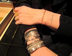 'Live' script tattoo - wrist (The bracelets are really cool, too!