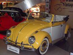 cheery yellow vw beetle convertible