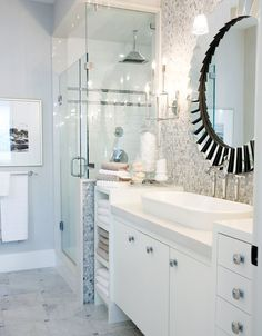 Shower tucked into wall beside vanity. Towel storage.  Designed by Sarah Richardson, Orginally featured in the October 2008 Style at Home issue, love her! And Tommy too!