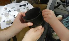 Little hands (with big hands helping) assembling a pot  www.flattireflowerpots.com
