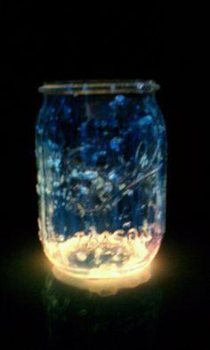 Take a mason jar... cut open the glow stick... pour the glow stick into the mason jar. Glow Jar