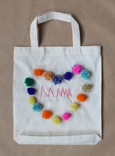 DIY Mother's Day embellished tote with handmade pom-poms