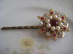 Repurposed Vintage Brooch into Hair Pin / Ruby Red, Diamond Rhinestone and Pearl. $12.00, via Etsy.
