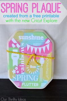 a cute tie-dye spring plaque made using the new Cricut Explore machine