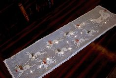 crocheted reindeer and sleigh table runner (paid pattern)