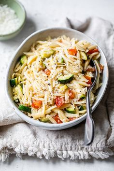 Orzo with Zucchini and Tomato is a quick and easy side dish that goes great with chicken, pork chops, or double the portion and enjoy it as a main dish. #sidedish #orzo #vegetarian #skinnytaste