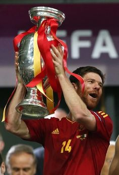 Xabi Alonso lifting the cup