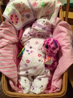 "Baby shower gift...roll up diapers and place them inside an infant outfit...place ""infant"" on their tummy. Spiral roll diapers into a circle, place pacifier in between a few diapers and add a hat. Adorable gift for a new mom."