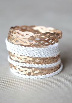 """Sweet Sorbet Bangle Set In White 16.99 at shopruche.com. This set of nine plaited bangles is perfected in shimmering gold colored and painted white styles.2.75"""" wide"""