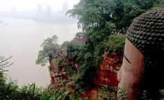 The head of the Giant Buddha in Leshan, China, is covered with 1,021 intricate, twisted hair buns hiding a complex drainage system that helps preserve the statue.  (Kounosu/Wikimedia Commons)