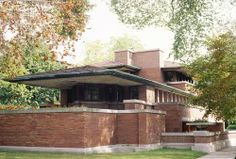 "1893-1920: Prairie Style  A Revolutionary New House Style by Frank Lloyd Wright  Frank Lloyd Wright transformed the American home when he began to design ""Prairie"" style houses with low horizontal lines and open interior spaces.  The Frederic C. Robie House in Chicago is widely considered Frank Lloyd Wright's finest example of the Prairie style. It was built in 1909.    Prairie style houses usually have these features:    Low-pitched roof  Overhanging eaves  Horizontal lines  Central chimney  Open floor plan  Clerestory windows"