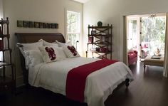 bedrooms - espresso wood sleigh bed wood lattice bookcases wall art red throw blanket red white lobster throw pillows bedroom  Brown & red bedroom