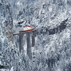 14 Beautiful Places Around the World - The Landwasser Viaduct is a single track six-arched curved limestone railway viaduct. It spans the Landwasser River between Schmitten and Filisur, in the Canton of Graubünden, Switzerland