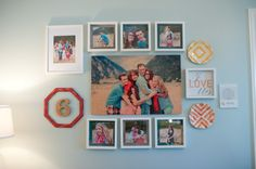 I used HGTV Home fabric behind the family pictures in this gallery wall to add dimension and color. #HGTVHomeMagic #diy tatertotsandjello.com