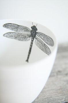 there's a dragonfly in my mug.