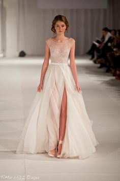 Top is beautiful! Cream crystal and tulle gown