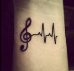 music tattoo with heartbeat. to symbolize music is always close to my heart