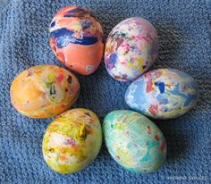 "Eggs decorated with melted crayon and then dye - a great way for kids to make ""fancy"" Easter eggs!"