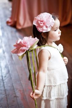 This #flowergirl #fairy holds a flower wand attached to a sash! Love the matching pink blooms in head and hand.  For more flower girl fun, tips & tricks, visit us at www.flowergirlworld.com