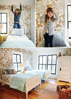 girls bedroom design - by Katie Hackworth.  Wallpaper by Anthro. I like the dark window frames :)