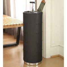 Black Leather Umbrella Stand. Product in photo is from www.wellappointedhouse.com