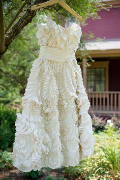 I like this idea for a wedding dress picture- outside, hanging on a tree!