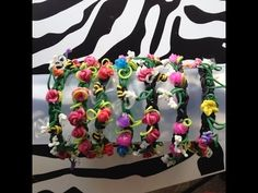 Rainbow Loom ROSEBUD Bracelet. Designed and loomed by Sea wolfe. Click photo for YouTube tutorial.