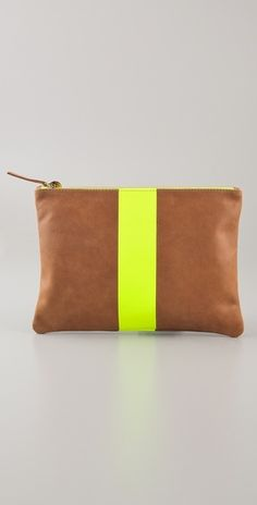 neon yellow and nude clutch bag