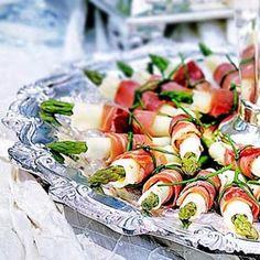 Prosciutto Wrapped Asparagus Served on Silver....