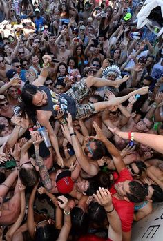 Steve Aoki surfs the crowd at #WetRepublic during Electronic Daisy Carnival on June 21, 2013