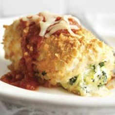 Chicken Parmesan Bundles- chicken stuffed with cream cheese, parm cheese, mozzarella cheese and spinach. Topped with pasta sauce and mozzarella cheese.