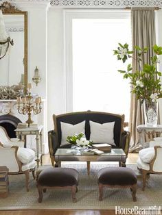 An elegant living room with an old world feel. Design: Annie Brahler