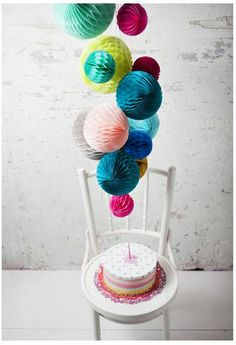 love the color combination. kind of into the paper ball style too, maybe in addition to the lanterns. . . .
