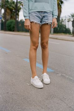 White sneakers and loose shorts