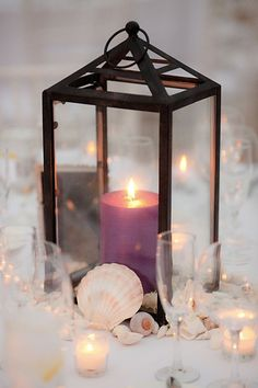 plum candle with rustic lanterns