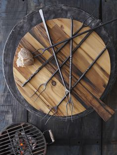 Forged iron roasting forks! Perfect for summer fire pits, grills and camping! And the rustic round bread boards.. our new order from Roost! Available at Aubergine in Woodstock, VT.