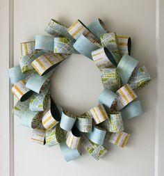 Paper Wreath Tutorial at Scrapbuck.com.  Make a handmade wreath at home with just paper, cardboard & Staples for $3.00 or less!