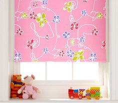 This pretty pink roller blind will help little ones to drop off for an afternoon nap. #interiordesign #blackoutblinds #kidsrooms
