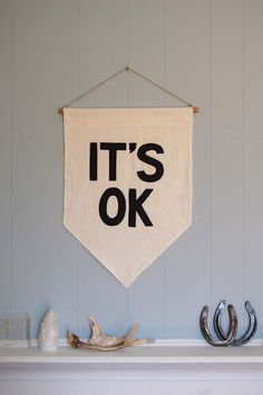 25-dorm-decor-diy-ideas: it would be easy to make a sign like this out of material and a wood rod - whatever phrase you prefer