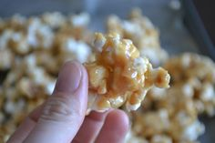Peanut Butter and Honey Popcorn - 8 cups popped popcorn (air popped or unbuttered microwave popcorn), 1/2 cup sugar, 1/2 cup honey, 1/2 cup peanut butter, 1/2 teaspoon vanilla