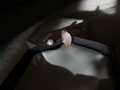 White moonstone and diamond lash wink bangle by CRWN Jewelry