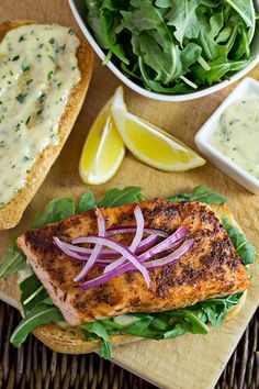 Spicy, Cajun Salmon Fillet on a Rustic Roll with Arugula and Lemon Aioli—classic, bistro comfort food.