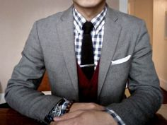 a great layered look with a lot of details: gingham shirt, cardigan sweater, gray blazer, tie with tie bar, pocket square. Just need a low cut cardigan.