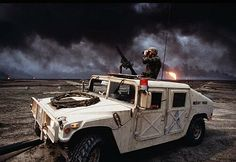 Operation Desert Storm - U.S Military troops patrolling burning oil fields in Kuwait during the Persian Gulf War (1990-1991)